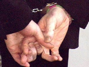Michael Jackson hands handcuffed