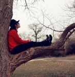 Michael Jackson in Neverland on his tree